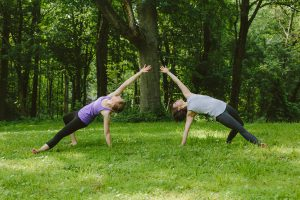 Two yoga instructors mirroring a pose